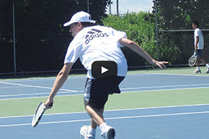 Tennis Camps - Boy Tennis Player Backhand Shot