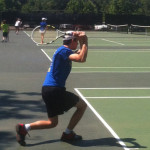 Tennis Camps - Boy Tennis Player Follow Through