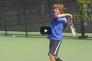 Tennis Camps - Boy Tennis Player Follow Through