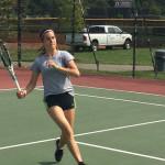 Tennis Match - Running Up for Shot