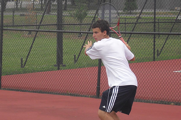 Tennis Camps - Boy Tennis Player Returning Serve Michael Filipek Tennis Academy