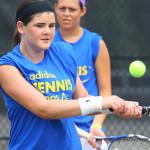Tennis Match Play - Boy Returning Shot